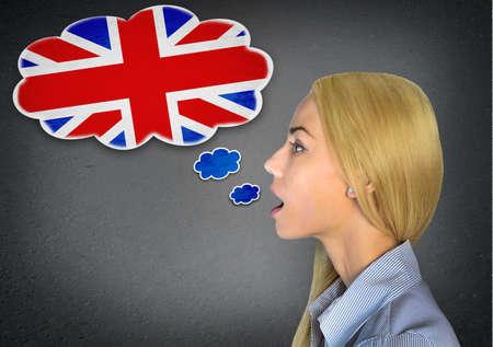 Woman speaking english in bubble Foto de archivo
