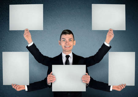 Business man with empty board photo