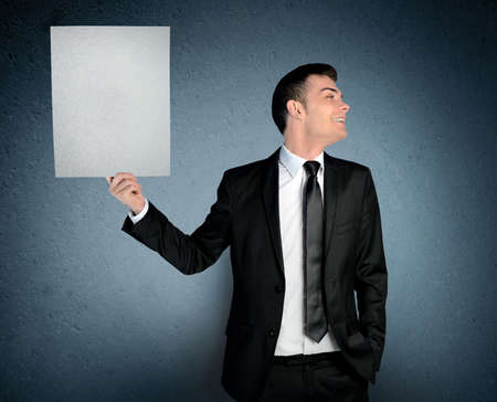 Man laugh with empty paper board photo