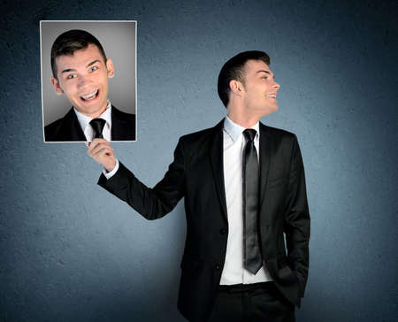 Man laugh at picture with crazy face photo
