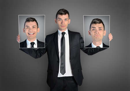 happy faces: Business man with different faces Stock Photo