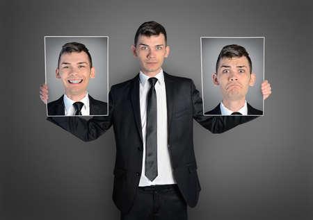 caras graciosas: Hombre de negocios con diferentes caras Foto de archivo