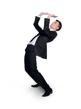 Isolated business man pushing nothing photo