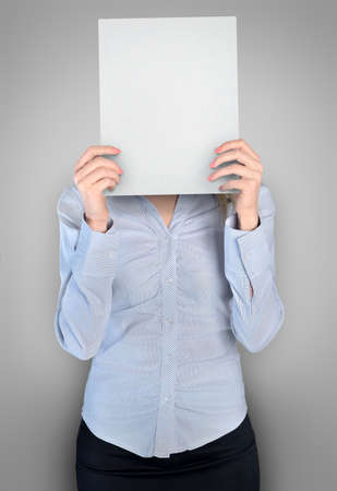 Business woman cover face with empty board photo