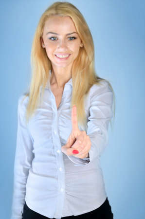 Business woman finger touching something photo
