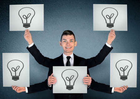 Business man with many ideas photo