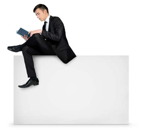 Business man reading on empty board photo