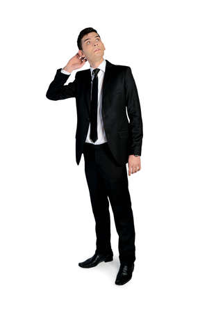 incertitude: Isolated business man looking up