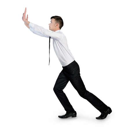 empujando: Hombre de negocios aislados empujando algo Foto de archivo