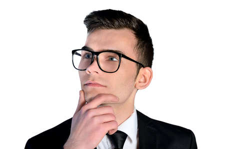 Isolated young business man think photo