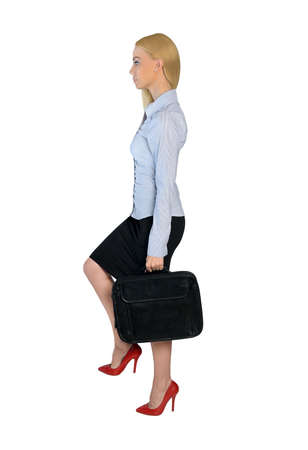 step up: Isolated business woman step up Stock Photo