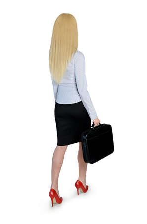 Isolated business woman walk back view photo
