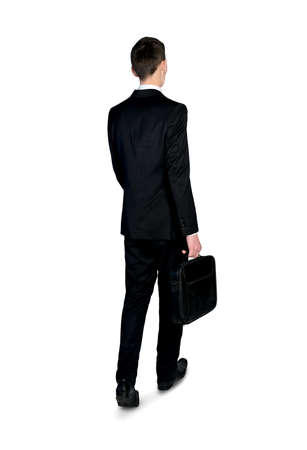 away: Isolated business man walking back view