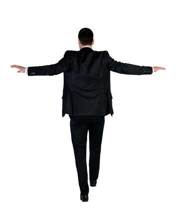 risky: Isolated business man walk risky