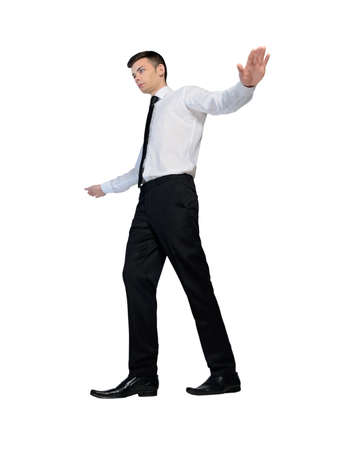 Isolated business man walking on imaginary rope photo