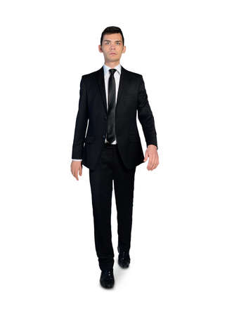 Isolated business man walking forward photo