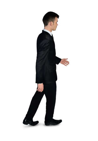 Isolated business man walking side photo