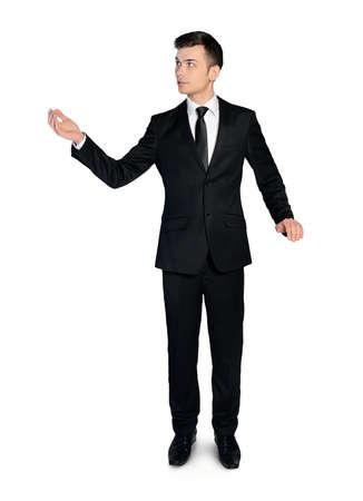 Isolated business man point something photo