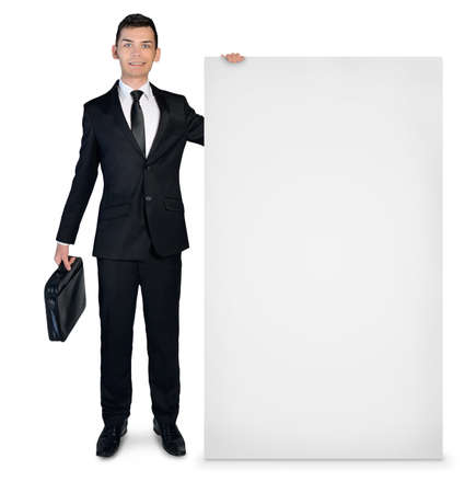 Isolated business man presenting empty board photo