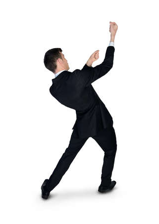 grabbing back: Isolated business man drag something Stock Photo