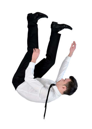 cabeza abajo: Hombre de negocios aislados caer