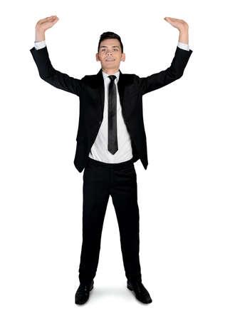 Isolated business man lifting something photo