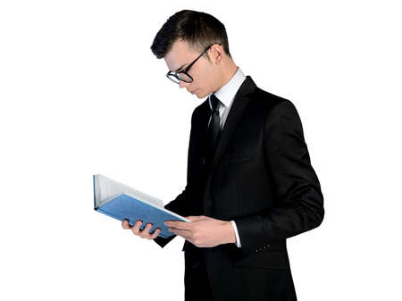 Isolated business man reading book photo