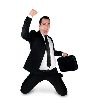 kneel down: Isolated business man winner hand up Stock Photo