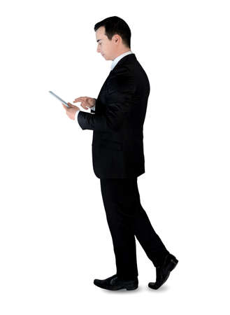 Isolated business man with tablet photo