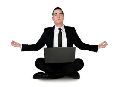 meditation isolated white: Isolated business man meditation with laptop