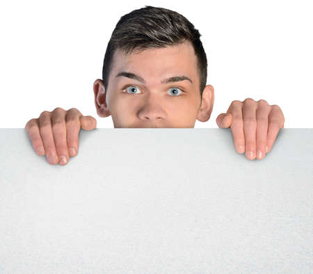 Isolated business man behind empty board photo