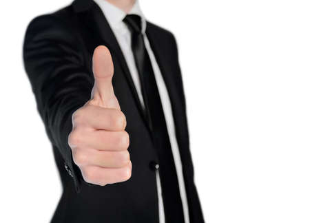 Isolated business man show ok sign photo