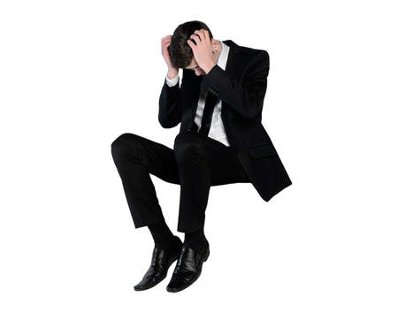 sit down: Isolated business man sad looking down Stock Photo