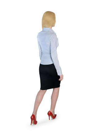 Isolated business woman walk back photo