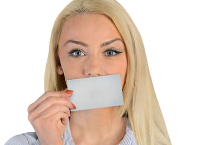 Isolated business woman cover lips with card photo