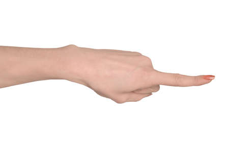 Woman hand pointing side closeup photo