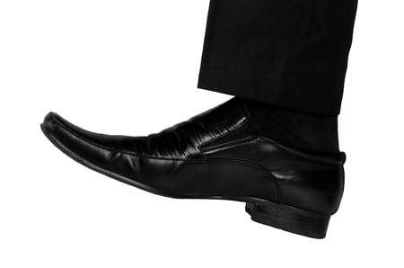 crush on: Hombre de negocios aislado aplastamiento del pie algo Foto de archivo