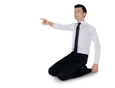 Isolated business man pointing side
