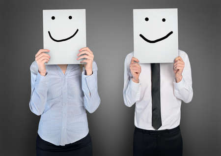 Smile shape on paper in ahnds of business womana nd man Stock Photo