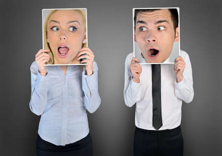 man shouting: Surprised face of business woman and man Stock Photo