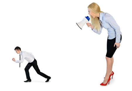 Business woman screaming on megaphone on little man photo