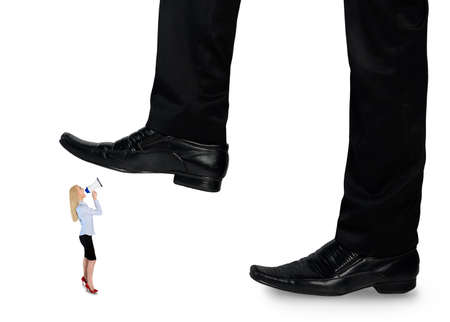 trample: Isolated feet man crushing little business woman Stock Photo