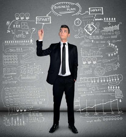 Business man writing business plan Standard-Bild