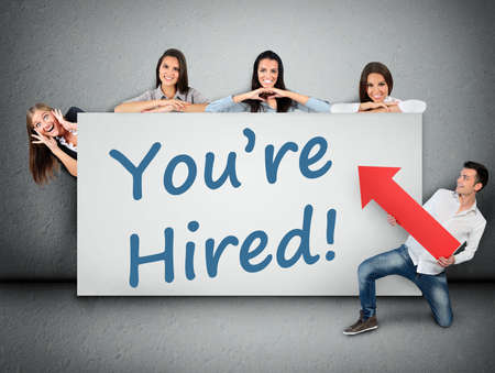 hired: You are hired word writing on white banner Stock Photo
