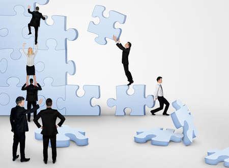 Business team bâtiment pièces de puzzle ensemble