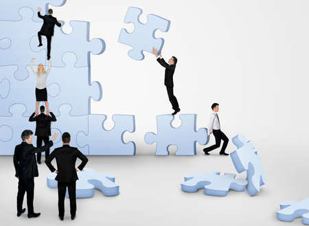 puzzle background: Business team building puzzle pieces together