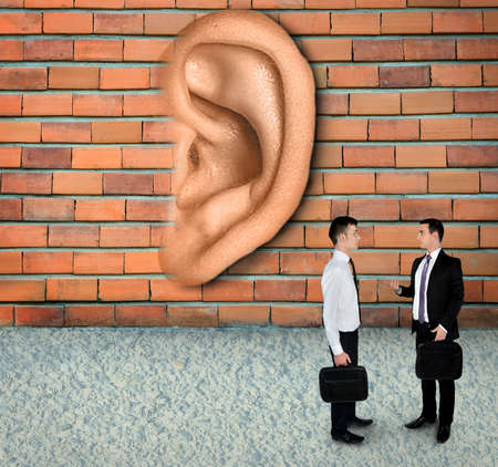 investigators: Wall have ears concept listening business meeting Stock Photo