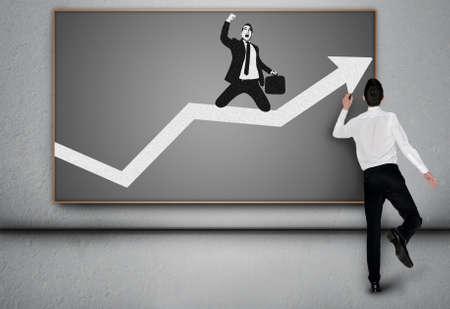 winner man: Young business man write success arrow on blackboard