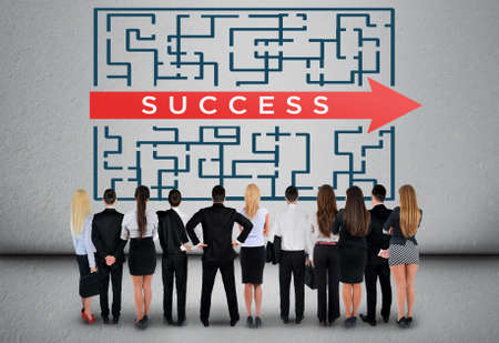 Success word maze and business team thinking solution photo