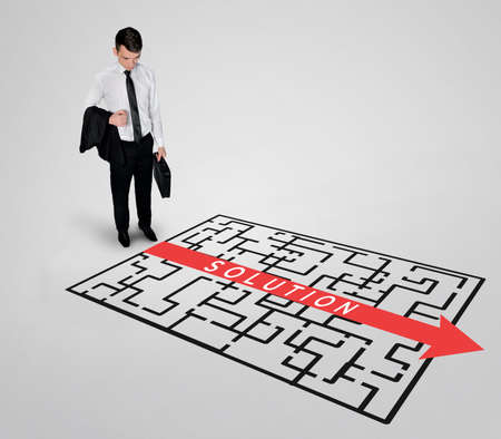 solved maze puzzle: Solution word maze and business man thinking solution